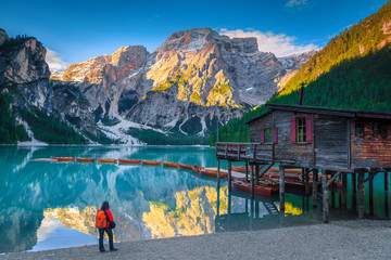 Wall Mural - Active tourist on the shore of lake Braies, Dolomites, Italy