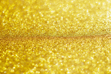Abstract gold glitter sparkle with bokeh light background