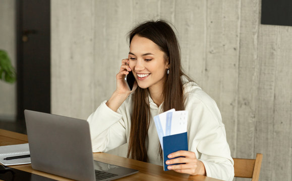 Freelance travel agent. Woman with passport and tickets