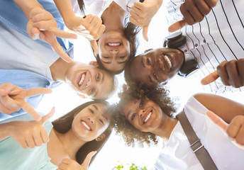 Joyful Multicultural Teenagers Standing In Circle, Showing Funny Gestures, Low Angle Fotomurales