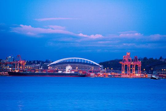 West Seattle bridge and port cranes over Elliot bay at evening time, Washington, USA