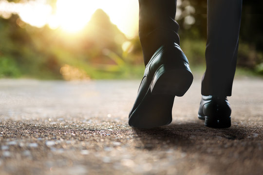 Vision and Successful Concept. Challenging in Career. Low Section of Businessman Walking in Outdoor. Natural Sunlight as background
