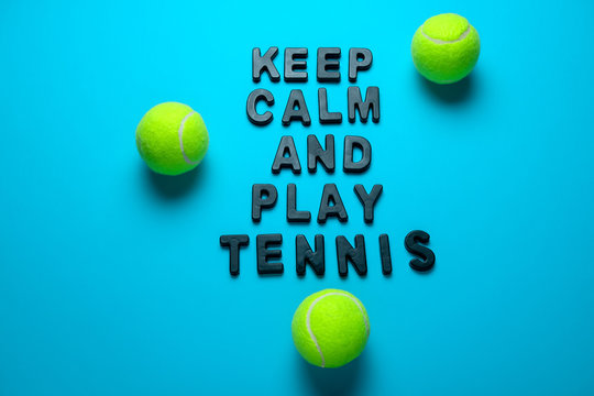 top view flat lay tennis balls and inscription keep calm and play tennis  on a bright blue background