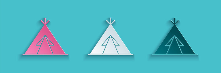 Paper cut Traditional indian teepee or wigwam icon isolated on blue background. Indian tent. Paper art style. Vector Illustration