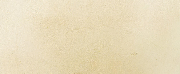 close up retro plain cream color cement wall panoramic background texture for show or advertise or promote product and content on display and web design element concept