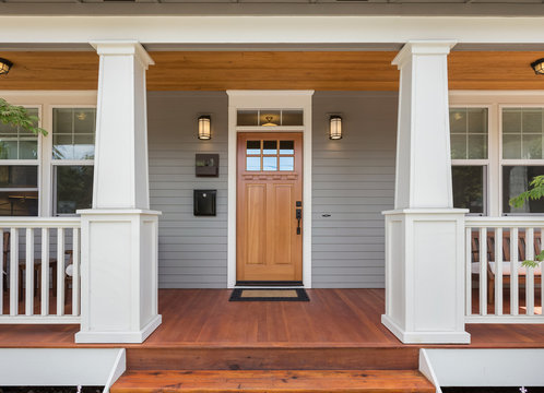Covered porch and front door of beautiful new home