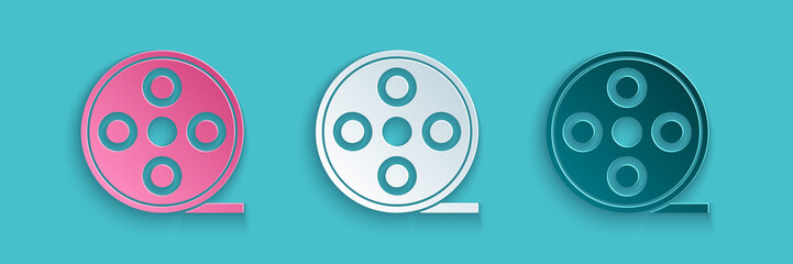 Paper cut Film reel icon isolated on blue background. Paper art style. Vector Illustration