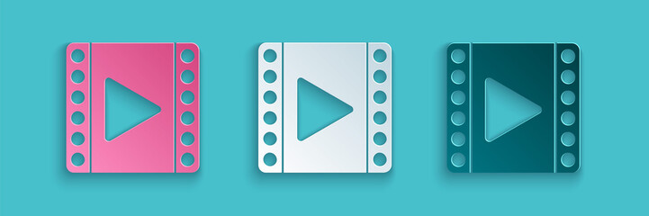 Paper cut Play Video icon isolated on blue background. Film strip sign. Paper art style. Vector Illustration