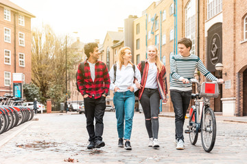 Teen group of friends walking together in the city