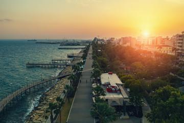 Fotobehang Cyprus Limassol at sunset, aerial evening panorama of Molos promenade, Cyprus island. Mediterranean skyline.