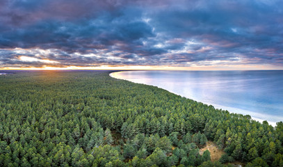 Printed kitchen splashbacks Khaki Sunset over coastline at Baltic sea. Aerial view on lighthouse and forest in background.