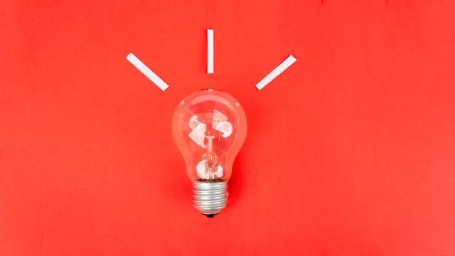 Top view of light bulb on red background