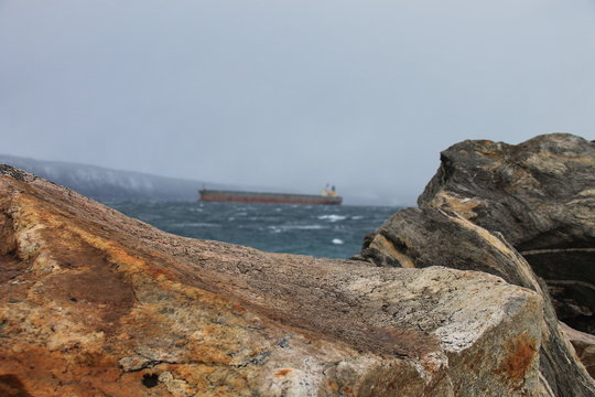 Cargo ship close to the coast