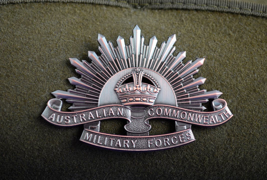Australian army soldier slouch hat with Anzac WWI rising sun hat badge, close up. Adelaide, Australia - March 18, 2015: