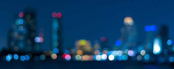 Banner cover of blurred bokeh cityscape at twilight time, city background, aerial view angle from...