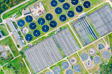 aerial top view of round water settlers for sewage recycling. modern wastewater treatment plant