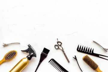 Beauty saloon accessories - combs, sciccors for hairdressing - on white background top-down frame copy space