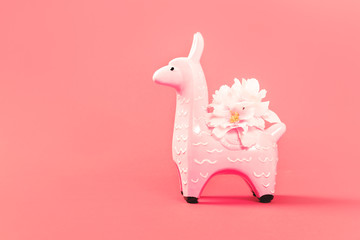 Stores à enrouleur Lama Pink zine type toy alpaca llama with flowers on a pink monochrome background close up, coin bank. Creative and fun trendy collage of funky animal concept with copy space