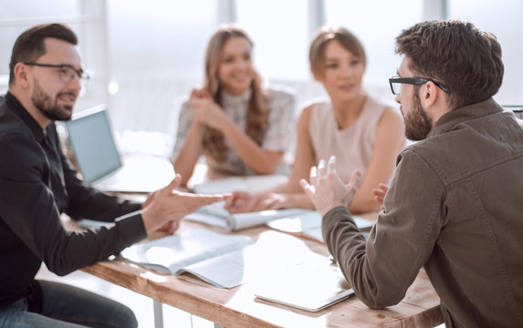 business partners hold a dispute at a meeting in the office