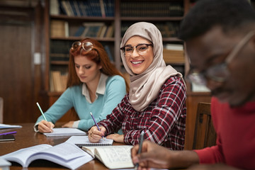 Islamic student at library