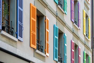 Windows with different color shutters. Geneva, Switzerland