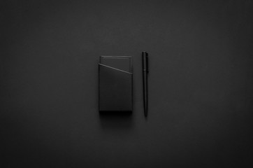 Name card box and pen in modern lifestyle on dark background for minimalist flat lay black concept..