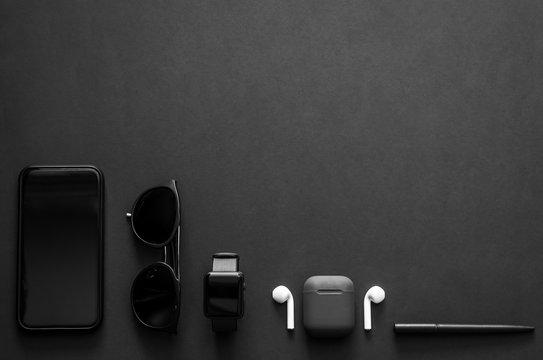 Men gadgets in modern lifestyle on dark background for minimalist flat lay black concept..