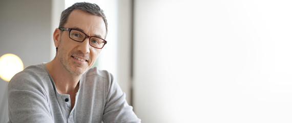 Template portrait of smiling middle-aged man with eyeglasses