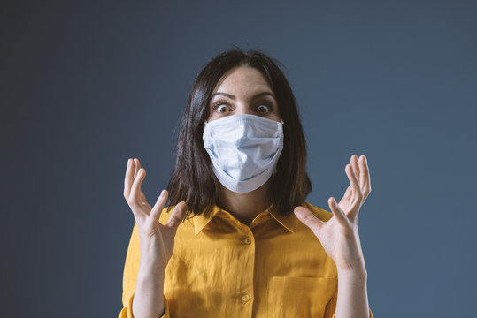 Panicked woman wearing a face mask against covid-19