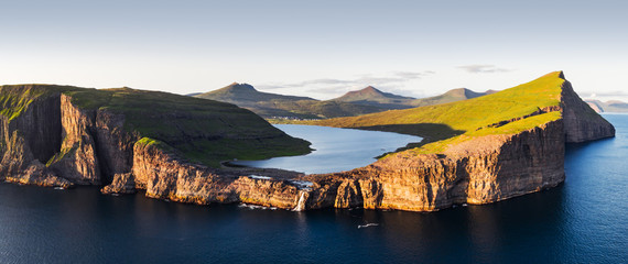 Aerial view from drone of Sorvagsvatn lake on cliffs of Vagar island in sunset time, Faroe Islands, Denmark. Landscape photography Wall mural
