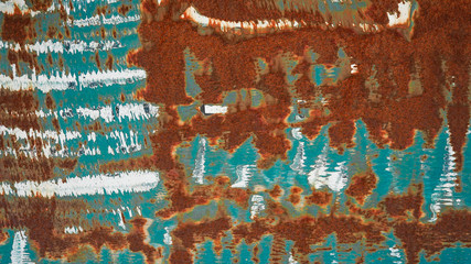 Rusty turquoise white painted peeled metal wall texture background, with space for text