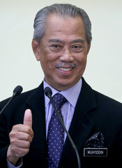 Malaysia's Prime Minister Muhyiddin Yassin gestures after his cabinet announcement in Putrajaya