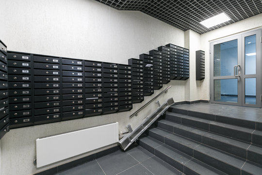 mailboxes in the lobby of an apartment building