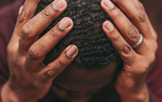 black african american man depicting a sad depressive state, depression concept