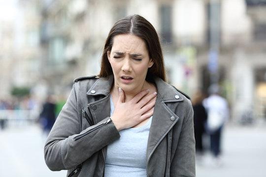 Woman suffering lack of breath on street