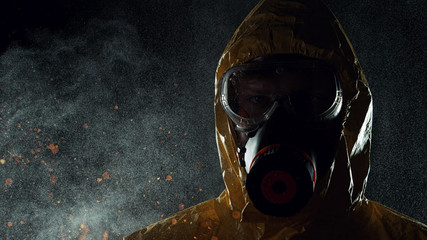 Man in chemical suit with respirator and goggles. Wall mural