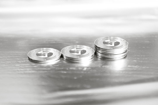 Tether (USDT) digital crypto currency. Stack of silver coins against the background of numbers. Cyber money.