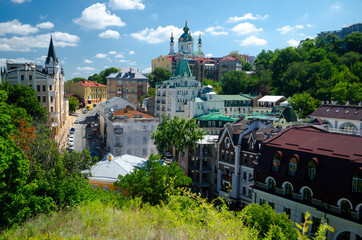 Foto auf Leinwand Kiew Panorama of the city of Kiev from the castle mountain. City street with colored European houses. Vozdvizhenskaya street. Kiev, Ukraine, July 16, 2017