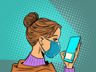 woman in medical mask reads a smartphone