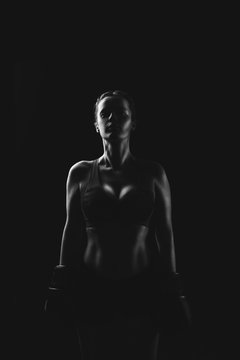 Sport. Portrait of a woman in boxing glove.