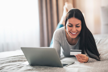 Girl using her credit card for online shopping.