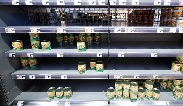 A supermarket shelf with canned lentil and pea stew is seen partly empty and not yet refilled on Monday, following panic buying over the weekend due to the coronavirus (COVID-19), in Bad Honnef near Bonn