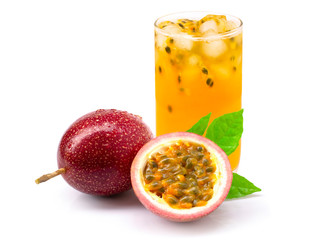 Closeup glass of passionfruit ( maracuya ) juice with passion fruit half slice with green leaf isolated on white background. Healthy drinks concept.