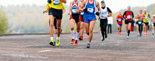 Fototapete - group man athlete runners run on road city marathon race