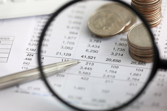 View at financial details in table thru magnifying glass