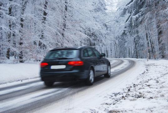 Black car in a frozen winter forest