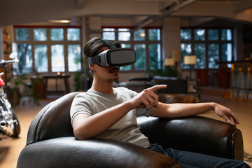Young man using a VR headset