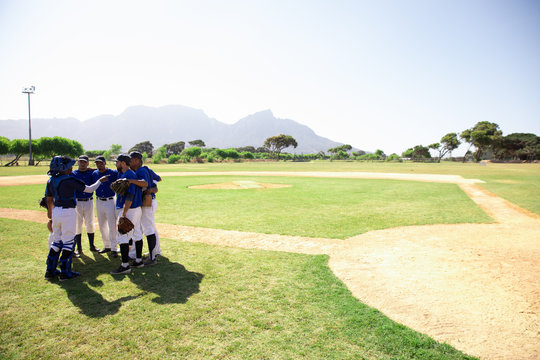 Baseball players talking with each other before match in field