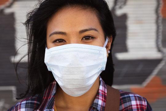 Woman wearing a Corona Virus face mask and looking at camera