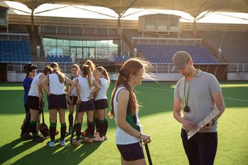 Female hockey players preparing match on the field